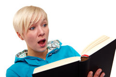 Reading a scary book Royalty Free Stock Image