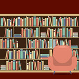 Reading Seat In Front Of A Bookcase Royalty Free Stock Photo