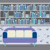 Reading Seat In Front Of A Bookcase Royalty Free Stock Photography