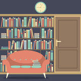 Reading Seat In Front Of A Huge Bookcase Royalty Free Stock Photography