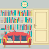 Reading Seat In Front Of A Huge Bookcase Royalty Free Stock Photo