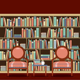 Reading Seats In Front Of A Bookcase Royalty Free Stock Photography