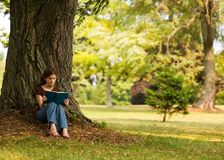 Reading in the Shade Royalty Free Stock Images
