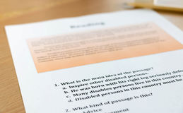 Reading sheet on table Royalty Free Stock Photo