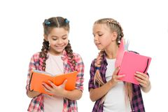 Reading skills. Cute small children holding books. Adorable little girls with school exercise books. Preparing activity. Books for writing. Study language royalty free stock image