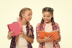 Reading skills. Cute small children holding books. Adorable little girls with school exercise books. Preparing activity
