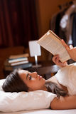 Reading before sleep. Stock Image