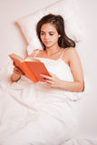 Reading before sleep. Royalty Free Stock Image