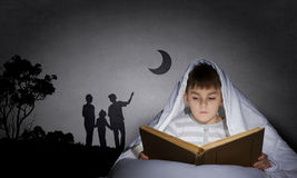 Reading before sleep Royalty Free Stock Photography