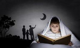 Reading before sleep Royalty Free Stock Photos