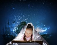 Reading before sleep Royalty Free Stock Photo