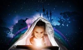 Reading before sleep Royalty Free Stock Photography