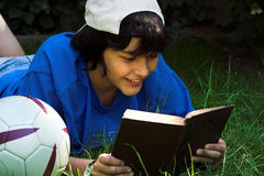 Reading with a smile stock photography