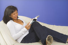 Reading and smiling Royalty Free Stock Photo