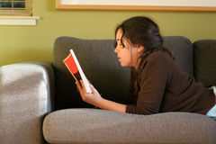 Reading on the sofa Royalty Free Stock Image
