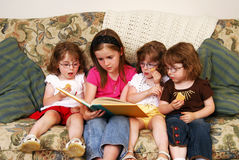 Reading a story Stock Photography