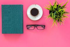 Reading for study and work. Self-education concept. business literature. Books with empty cover near glasses, coffe. Plant on pink desk top view Stock Photography
