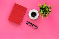 Reading for study and work. Self-education concept. business literature. Books with empty cover near glasses, coffe. Plant on pink desk top view stock photo