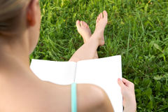 Reading in a summer day Stock Photo