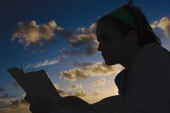 Reading at sunset Royalty Free Stock Photography