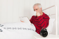 Reading with tablet Stock Photography