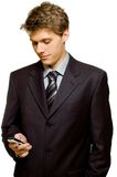 Reading text. Young handsome businessman reading a text message Royalty Free Stock Images