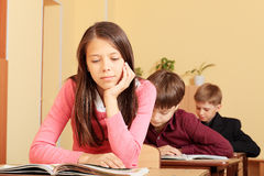Reading textbook. Educational theme: schoolchildren in a classroom Stock Images