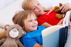 Reading their favorite book. Royalty Free Stock Photography