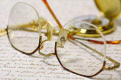 Reading Time. Eyeglasses, Letter and Watch Stock Photography