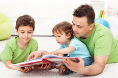 Free Reading Time With Father Royalty Free Stock Image - 24753086