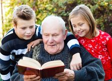 Reading to my grandchildren Stock Photo