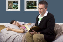Reading to Sick Daughter Royalty Free Stock Photos