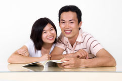 Reading together. Stock Photo