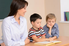 Reading together. Royalty Free Stock Photos