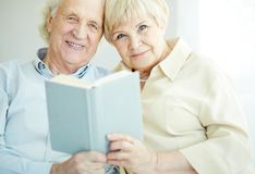 Reading together Stock Photos