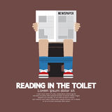 Reading in The Toilet Stock Photo