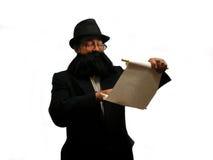 Reading the Torah. A Rabbi reading the Torah, over white Royalty Free Stock Photography