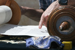Reading the Torah. A finger glides over the Torah at a young mans Bar Mitzva at the Wailing Wall, Jeruslem stock photo