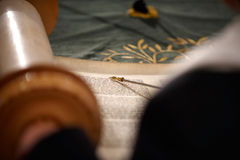 Reading torah. Torah scrolls with yad pointing at the text Royalty Free Stock Photo