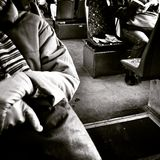 Reading in a tram. Artistic look in black and white. Stock Photo