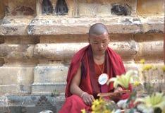 Reading tripatrika at Bodh Gaya Royalty Free Stock Photo