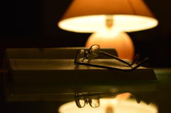 Reading under the lamp. Self-study & reflection by a lamp stock photos