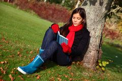 Reading under tree Stock Image