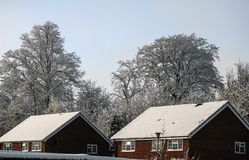 Snow covered houses royalty free stock images