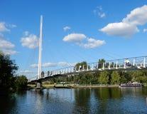 Sunny suspension bridge. Reading, United Kingdom - June 21 2018: The new Christchurch pedestrian suspension bridge over the River Thames ona sunny day stock image