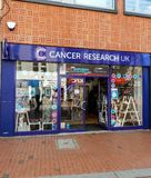 Cancer Research UK Shop. Reading, United Kingdom - May 09 2018:   The frontage of Cancer Research UK Charity shop in Broad street Royalty Free Stock Photo