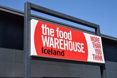 The Food Warehouse. Reading, United Kingdom - May 05 2018: The sign above the entrance of the Food Warehouse, a branch of Iceland, at Reading Link Retail Park royalty free stock photo