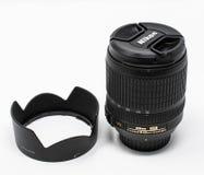 Nikon zoom lens. Reading, United Kingdom - September 29 2018: A Nikon AF-S Nikkor 18-105mm G ED standard zoom lens and it's lens hood royalty free stock images