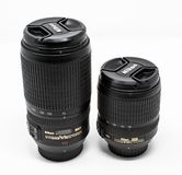 Pair of Nikon lenses. Reading, United Kingdom - September 29 2018: A Nikon AF-S Nikkor 70-300mm G ED telephoto zoom lens and a AF-S Nikkor 18-105mm G ED zoom stock image