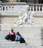 Reading on Vienna public building steps. Royalty Free Stock Photography